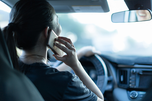 A woman talking on the phone while driving